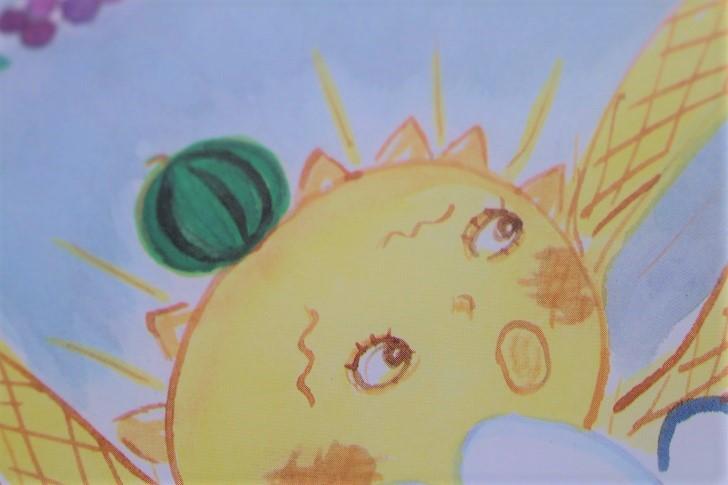 太陽の頭にスイカの絵